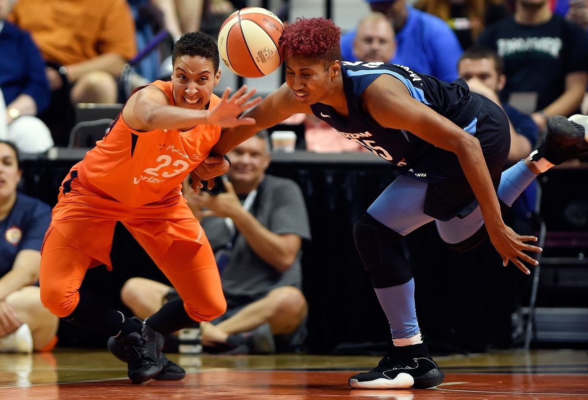 <b></b> Connecticut's Layshia Clarendon (23) battles Atlanta's Angel McCoughtry for a loose ball during the first half of Tuesday's WNBA game at Mohegan Sun Arena. Tiffany Hayes hit a halfcourt shot at the buzzer to give the Dream an 83-83 win. (Sean D. Elliot/The Day)