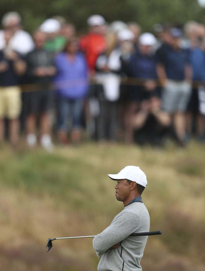 <b></b> Tiger Woods of the U.S. waits to play on the 12th green Wednesday during a practice round ahead of the British Open Golf Championship in Carnoustie, Scotland. (Jon Super/AP Photo)