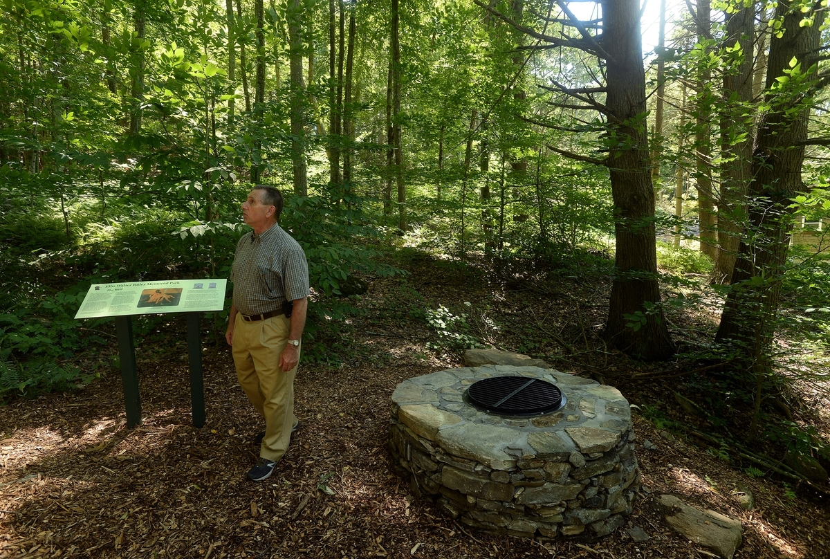 <b></b> Frank Manfredi, chairman of the Ellis Walter Ruley Project Committee, walks in the area of the partially rebuilt well Wednesday, July 18, 2018, while showing the work that has been done to create the Ellis Walter Ruley Memorial Park on Ruley's homestead property in Norwich.  (Dana Jensen/The Day)