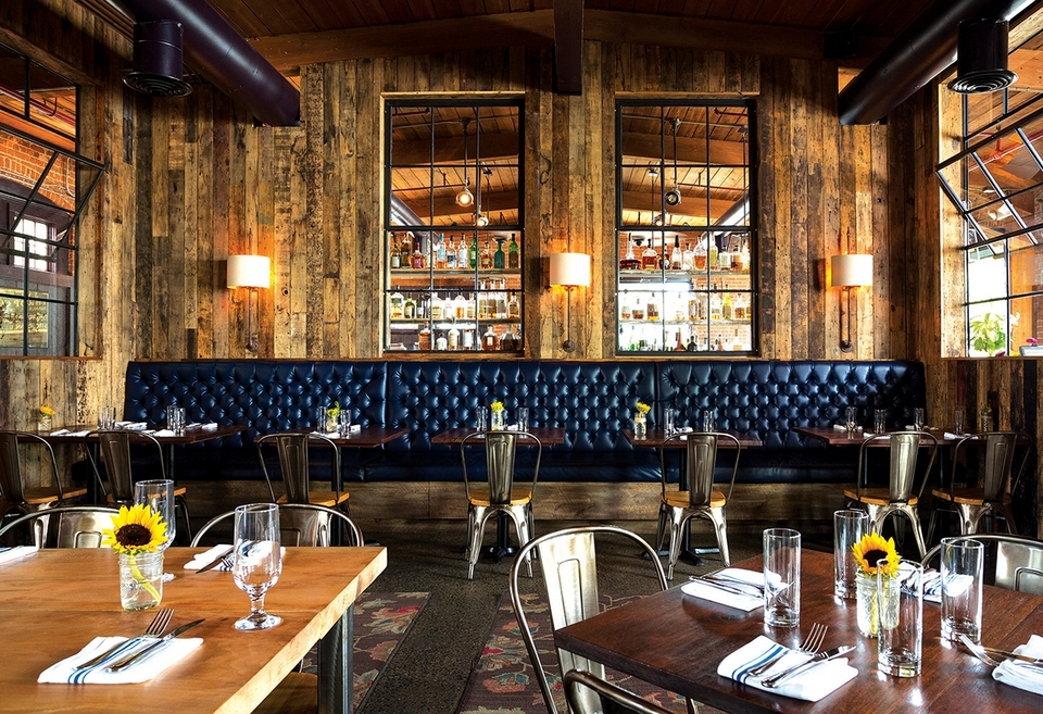 A wall-length booth graces one end of the dining room at The Engine Room in Mystic. (Photo courtesy of the Engine Room)