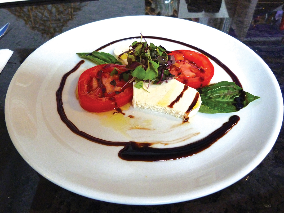 Fresh mozzarella with basil and balsamic reduction is on the menu at Stella's Restaurant & Pizzeria in Old Lyme. (Toni Leland photo)