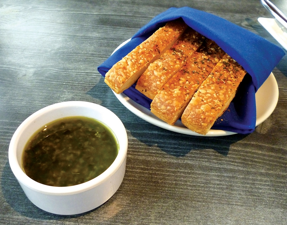 Fresh-baked foccacia with olive oil dip at Stella's. (Toni Leland photo)