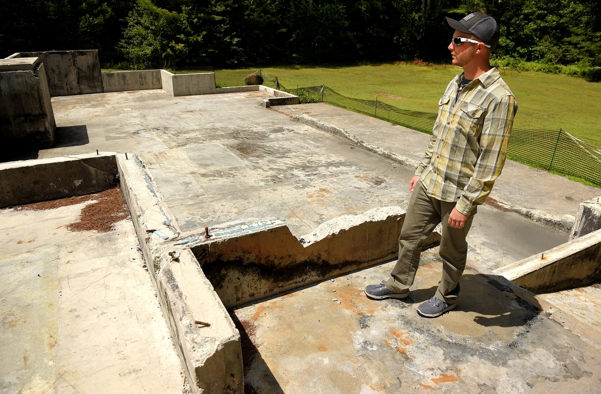 <b></b> Eric Lindquist at the remains of his family's home in Griswold Saturday, July 21, 2018. Lindquist's mother, father and brother were murdered last December, after which the assailants allegedly burned down the family's home. Eric, who was no longer living at the home, is the only surviving member of the family.  (Tim Cook/The Day)