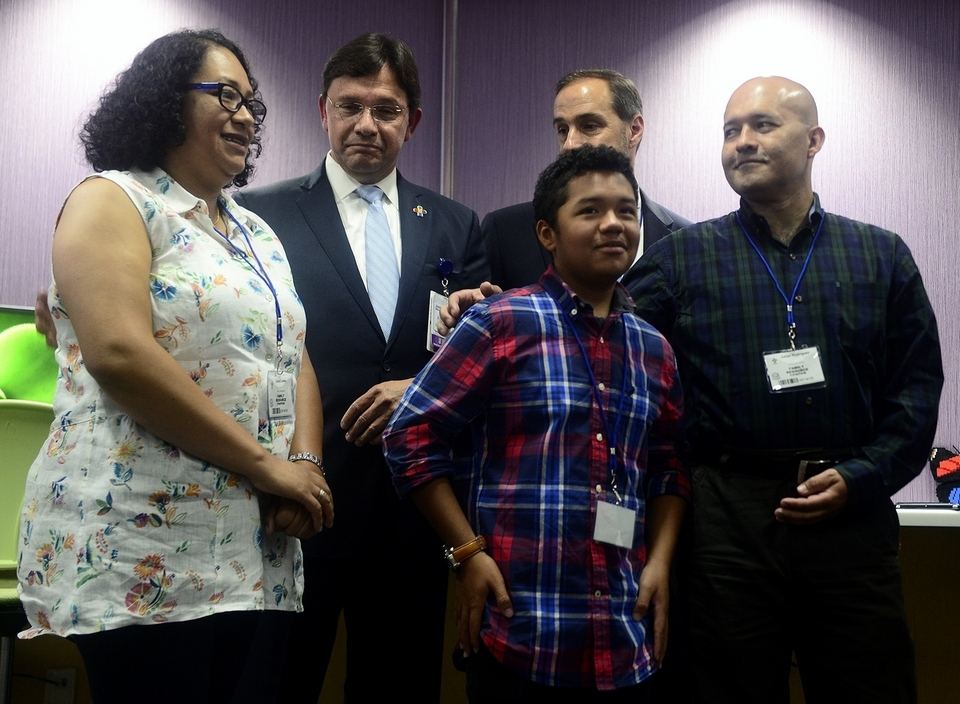 Julian Rodriguez, right, hugs his son Santiago as they stand at Connecticut Children´s Medical Center with his longtime partner, Diana Cortes, left, Dr. Juan Salazar, back left, and attorney Glenn Formica, back right, during a news conference Tuesday, Aug. 14, 2018, regarding Julian's deportation. Santiago suffers from a rare genetic disease that requires intensive, regular treatment at the center. (Sarah Gordon/The Day)