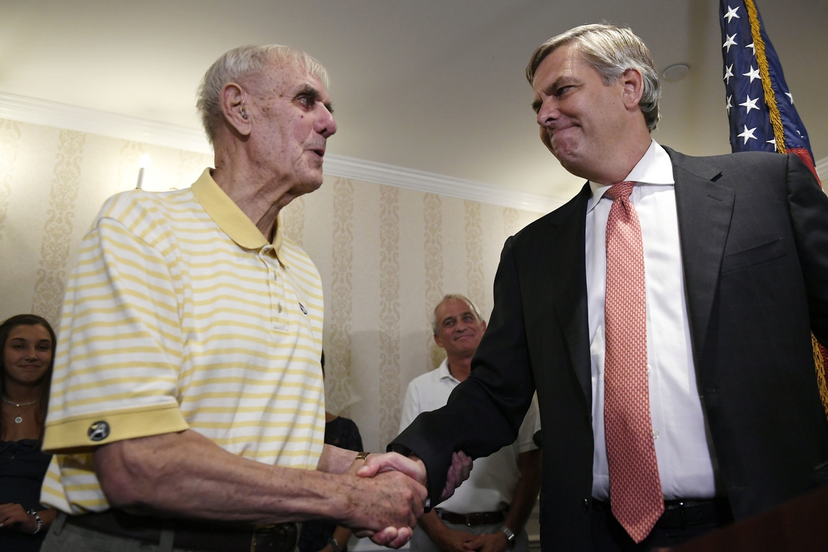 <b></b> Connecticut gubernatorial candidate Bob Stefanowski, right, shakes the hand of his  father, Bob Stefanowski Sr., after defeating four other contenders in the Republican primary, in Madison, Conn., Tuesday, Aug. 14, 2018. (AP Photo/Jessica Hill)