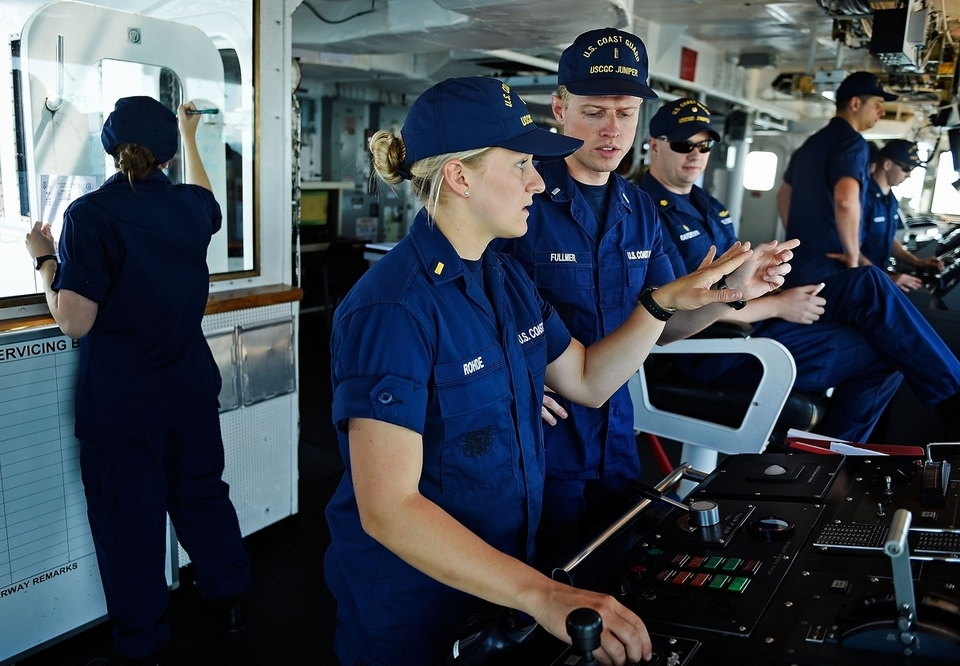 U.S. Coast Guard Ensign Dana Rohde, center, works with Lt. j.g. Austin Fullmer at the controls of the cutter Juniper as Ensign Emily Cox, left, records operational information during aids to navigation maintenance on two buoys Wednesday, Aug. 15, 2018. (Sean D. Elliot/The Day)