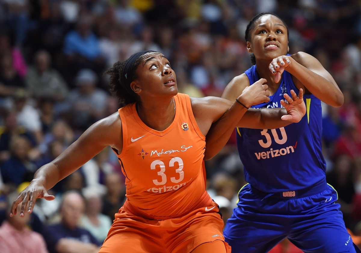 <b></b> Morgan Tuck of the Connecticut Sun, left, fends off Azura Stevens of the Dallas Wings in the first half of Tuesday's WNBA game at Mohegan Sun Arena. Tuck finished with 12 points in the Sun's 96-76 victory. The team plays again Friday at home against the Minnesota Lynx. (Sean D. Elliot/The Day)
