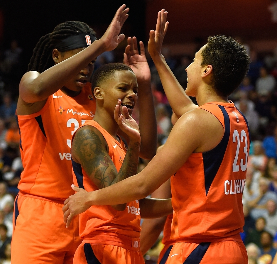 <b></b> Connecticut Sun center Jonquel Jones, left, and guard Courtney Williams, middle, congratulate teammate Layshia Clarendon after she scored and was fouled on a play against the Minnesota Lynx on Friday at Mohegan Sun Arena. The Sun used a strong second half to roll to the 96-79 win over the defending WNBA champion Lynx. (Sean D. Elliot/The Day)