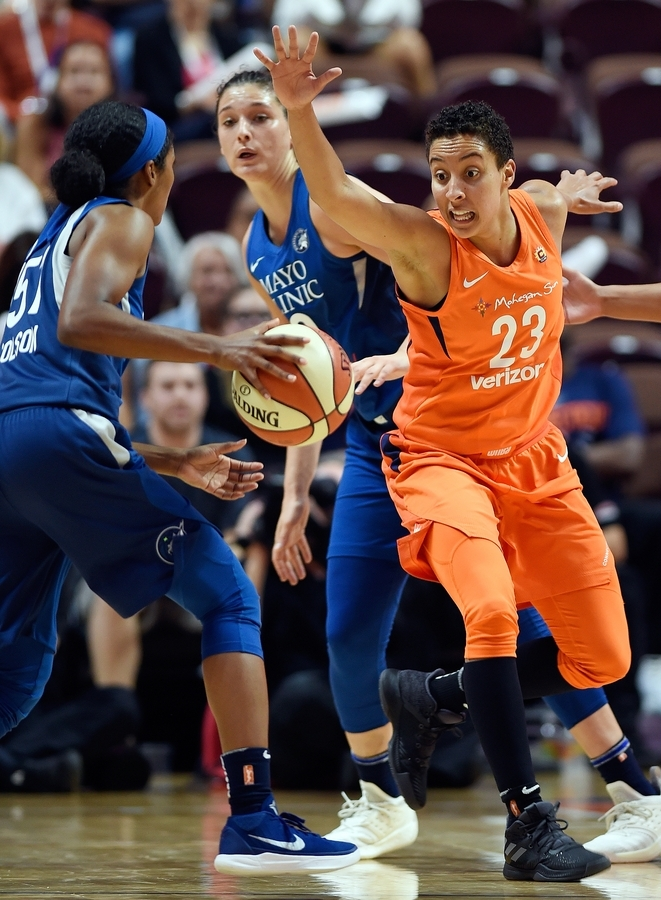 <b></b> Connecticut Sun guard Layshia Clarendon, right, charges Minnesota Lynx guard Sydney Colson on defense in the second half of Friday night's WNBA game at Mohegan Sun Arena. Clarendon finished with 14 points, five assists and three steals in 23 minutes off the bench in the Sun's 96-79 victory. (Sean D. Elliot/The Day)