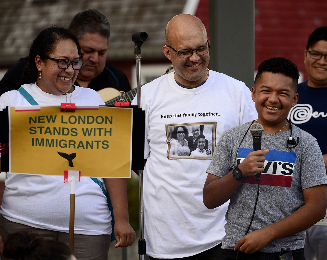 Hundreds of people attended an Aug. 27 rally for Diana Cortes, Julian Rodriguez and their son Santiago to protest federal immigration officials' decision to deport Rodriguez next month. Rodriguez was granted a stay of deportation Friday, allowing him to remain in the country another year. (Sarah Gordon/The Day)