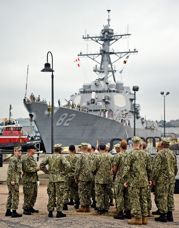 U.S. Navy personnel from the submarine base in Groton wait for the Arleigh Burke-class guided missile destroyer USS Lassen (DDG-82) to dock at Fort Trumbull State Park in New London, Sept. 6, 2018. The Lassen will be at the pier through Sunday for this weekend's Connecticut Maritime Heritage Festival. The Lassen, named for Medal of Honor recipient Commander Clyde Everett Lassen, will be open for tours Friday through Sunday. (Sean D. Elliot/The Day)