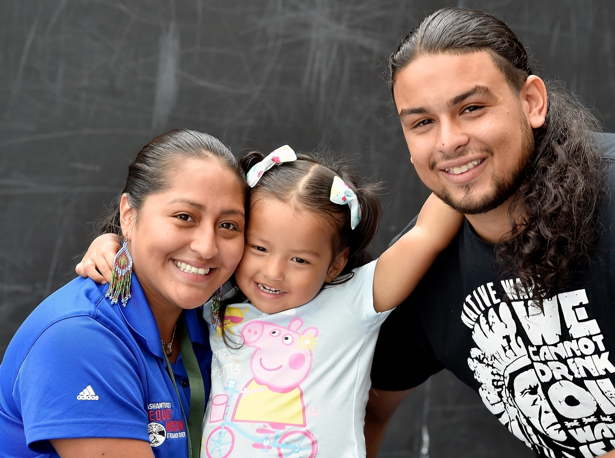 Ali Montoya Alvarado, left, of Ledyard, with her 3-year-old daughter Silvermist Northup and husband Nakai Clearwater Northup, at the Mashantucket Pequot Museum and Research Center on Friday, Sept. 7, 2018. Alvarado was arrested and being threatened with deportation to Mexico after letting her DACA status lapse for 10 days. Her husband and daughter are Mashantucket Pequot tribal members. Members of the community collected over $3000 through Go Fund Me, which will assist in legal proceedings. Ali is a part-time employee at the Mashantucket Pequot Trading Post located inside the museum. She also works two other part-time jobs.  (Tim Martin/The Day)