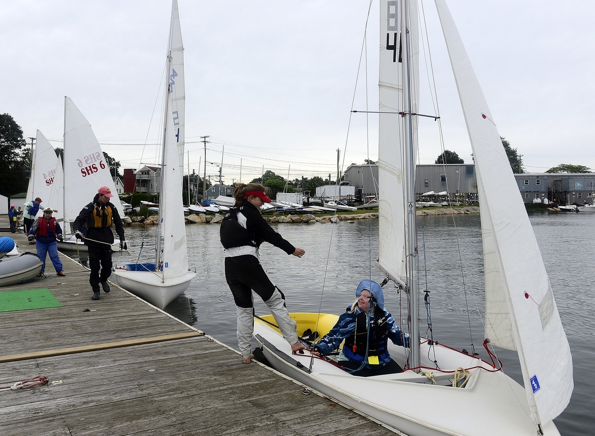 Lane Bolt, right, of Groton, laughs with teammate volunteer Caelan Desmond, of Stonington, as they push off the dock during the Special Olympics Sailing Regatta on Sunday, Sept. 9, 2018 at the Wadawanuck Club in Stonington. Teams from throughout the state and volunteers participated in the annual event that featured unified crews in races on ideal 18's, Sonars and 420's. (Sarah Gordon/The Day)