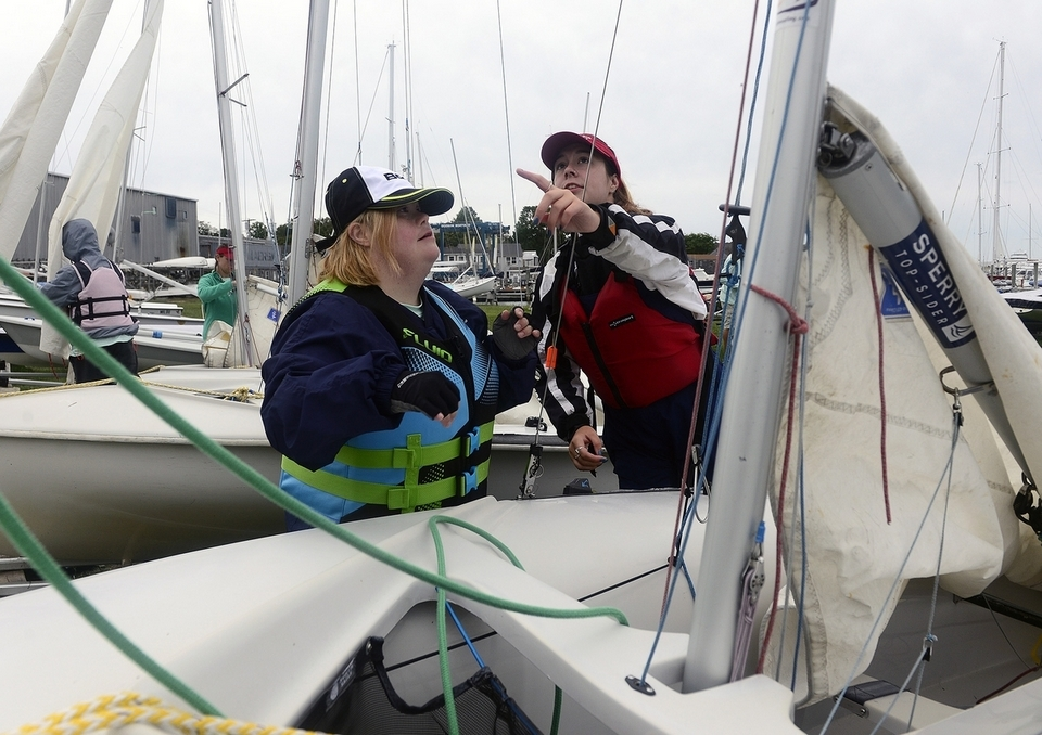 Elizabeth Kelly, left, of Groton, helps volunteer Emma Grimsley, of Stonington, set up their boat before the Special Olympics Sailing Regatta on Sunday, Sept. 9, 2018 at the Wadawanuck Club in Stonington. Teams from throughout the state and volunteers participated in the annual event that featured unified crews in races on ideal 18's, Sonars and 420's. (Sarah Gordon/The Day)
