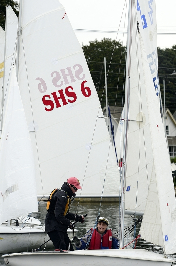 Nicy Iago, right, and volunteer Connor Rosow take off in their boat during the Special Olympics Sailing Regatta on Sunday, Sept. 9, 2018 at the Wadawanuck Club in Stonington. Teams from throughout the state and volunteers participated in the annual event that featured unified crews in races on ideal 18's, Sonars and 420's. (Sarah Gordon/The Day)