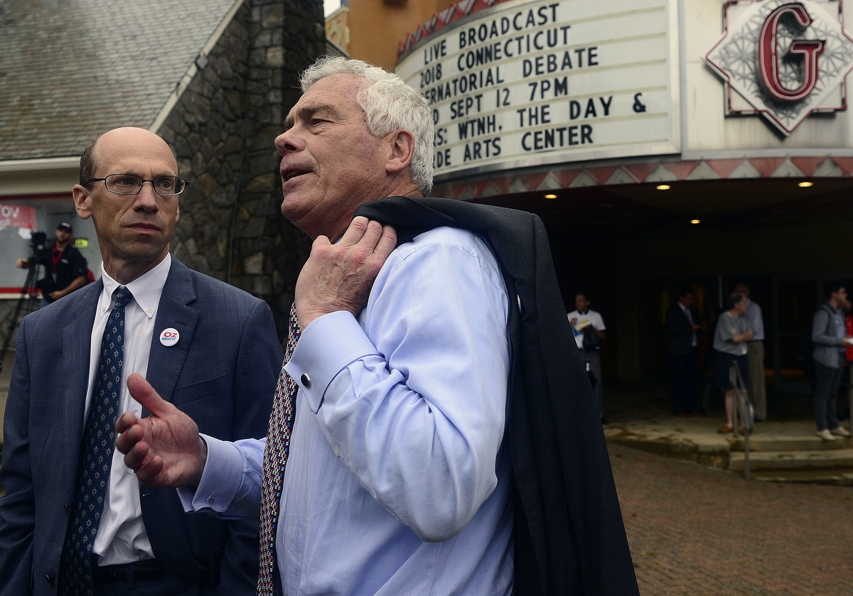 <b></b> Independent candidate Oz Griebel, right, and his running mate Monte Frank talk with reporters Wednesday, Sept. 12, 2018, outside The Garde before the first debate between Democrat Ned Lamont and Republican Bob Stefanowski. (Sarah Gordon/The Day)