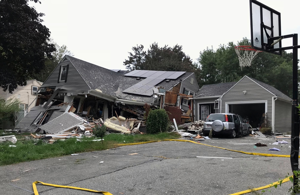 <b></b> A house is destroyed in Lawrence, Mass., Thursday, Sept. 13, 2018, after a series of gas explosions in the area. Norwich Public Utilities is sending personnel to Massachusetts to assist with the response to the rash of gas explosions and fires in three communities there. (Carl Russo/The Eagle-Tribune via AP)