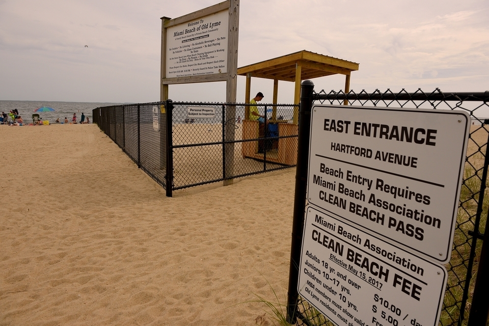 Beach-goers at Sound View Beach in Old Lyme are greeted with a new fence and admission booth separating Soundview and Miami beaches on June 29, 2017. Four Sound View Beach property owners allege in a civil lawsuit that the Miami Beach Association is interfering with the public's right of access to the beach in direct violation of a 1953 court order and does not have the authority to charge fees to the public for use of the public beach. (Tim Cook/The Day)