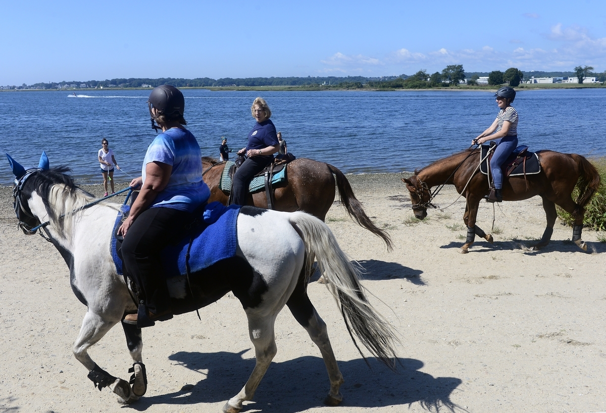 <b></b> Members of the Connecticut Trail Riders Association move down the path on Sunday, September 16, 2018 at Bluff Point. The group hosts weekly rides and new members are always welcome, see cttrailridesassoc.org for more details. (Sarah Gordon/The Day)