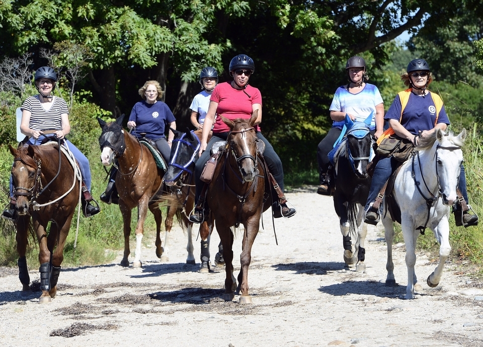 Members of the Connecticut Trail Riders Association move down the path on Sunday, September 16, 2018 at Bluff Point. The group hosts weekly rides and new members are always welcome, see cttrailridesassoc.org for more details. (Sarah Gordon/The Day)
