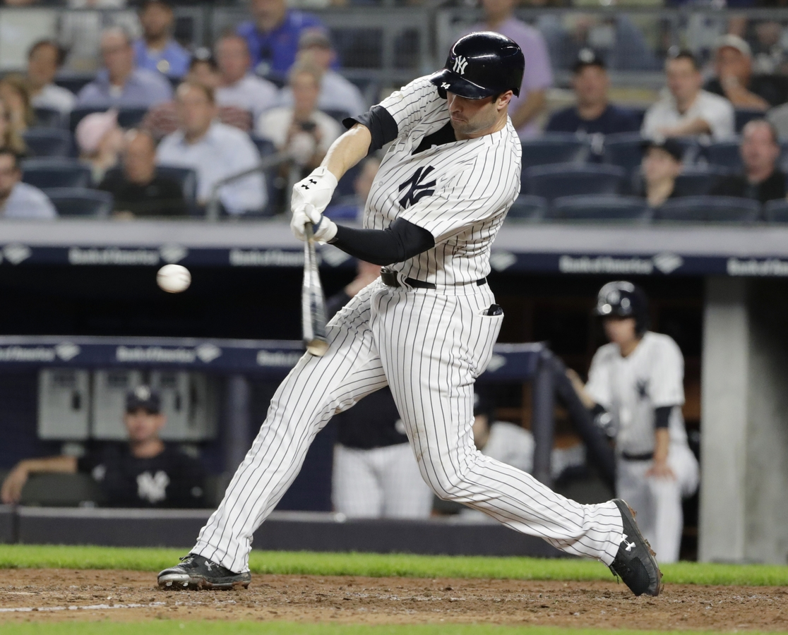 <b></b> Neil Walker of the New York Yankees hits a three-run home run during the seventh inning of Tuesday night's game against the Boston Red Sox at New York. The Yankees won 3-2. (AP Photo/Frank Franklin II)