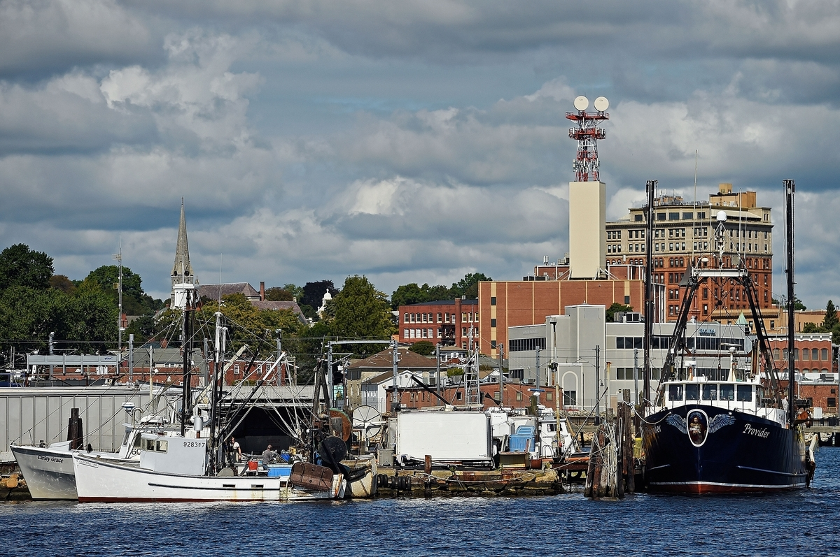 <b></b> The trawler Catherine-Amy, front left, approaches the dock where the Carley Grace, back left, and Provider are docked at New London Seafood Distributors in the Fort Trumbull section of New London on Thursday, Sept. 20, 2018.  (Sean D. Elliot/The Day)