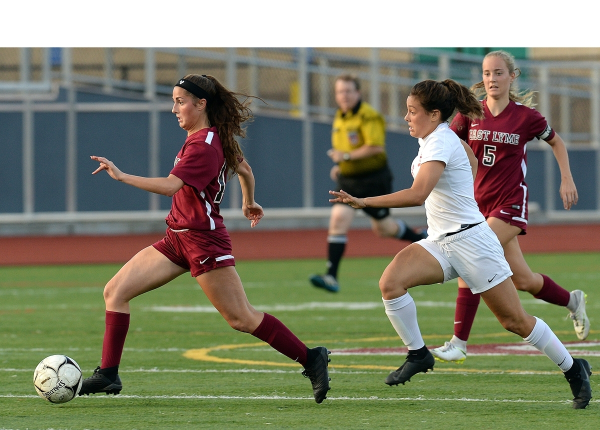 <b></b> East Lyme's Alivia Catanzaro, left, sprints away from NFA's Natalie Dionne during Thursday night's ECC Division I girls' soccer game at East Lyme. The Vikings and Wildcats played to a 1-1 double overtime draw. (Dana Jensen/The Day)