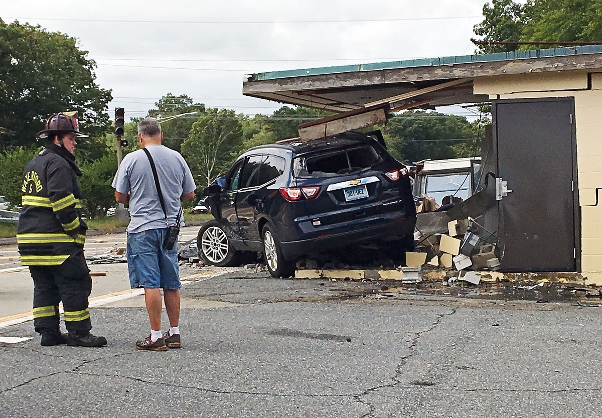 <b></b> A Chevrolet SUV drove through the weigh station off Interstate 95 south Friday morning, totaling the car and taking off the front end of the building. Troopers said they believed the driver was not seriously injured. A Waterford ambulance crew and the state Department of Transportation were on scene. (Lindsay Boyle/The Day)