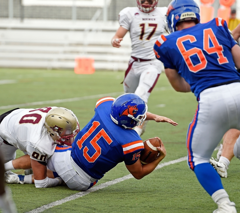 <b></b> Coast Guard Academy quarterback Ryan Jones dives into the end zone for the go-ahead touchdown with nine seconds remaining that lifted the Bears to a 38-35 win over Norwich University on Saturday at Cadet Memorial Field in New London. (Sean D. Elliot/The Day)