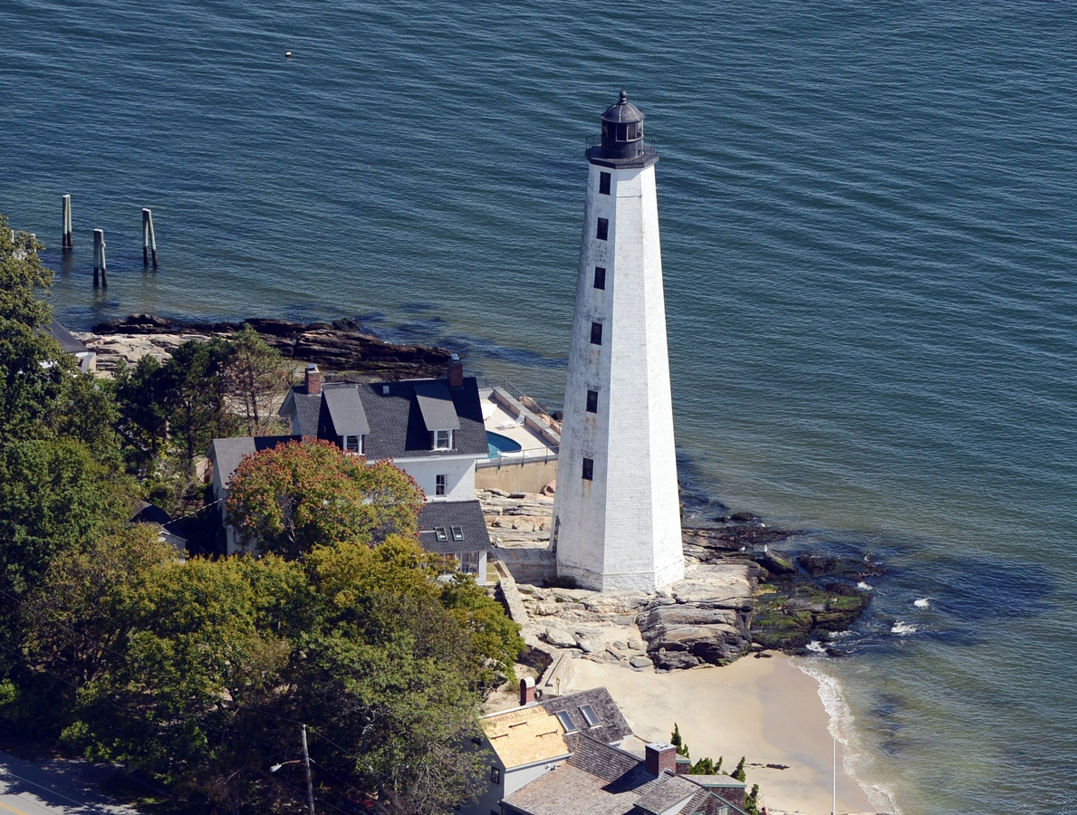 <b></b> New London Harbor Light is seen Sept. 14, 2013, from the air.  (Sean D. Elliot/The Day)