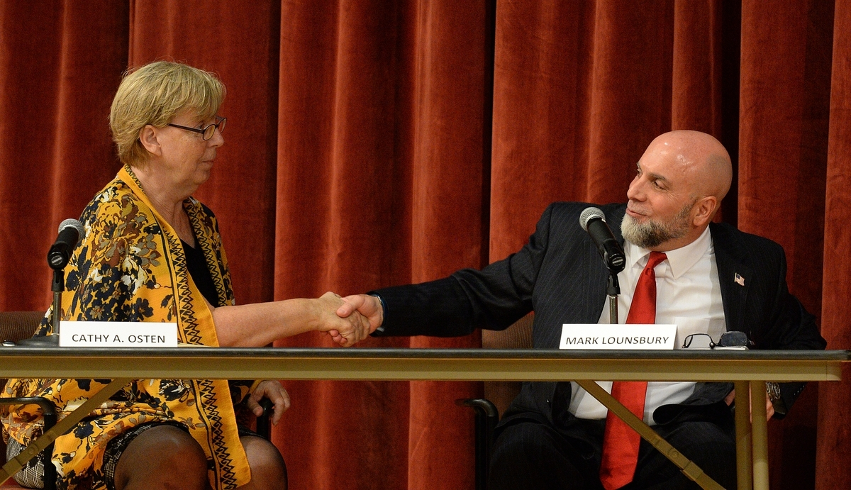 <b></b> Democratic incumbent state Sen. Cathy Osten and her Republican opponent, Mark Lounsbury, shake hands Thursday, Oct. 11, 2018, after their 19th District Senate debate at Kelly Magnet Middle School in Norwich.  (Dana Jensen/The Day)