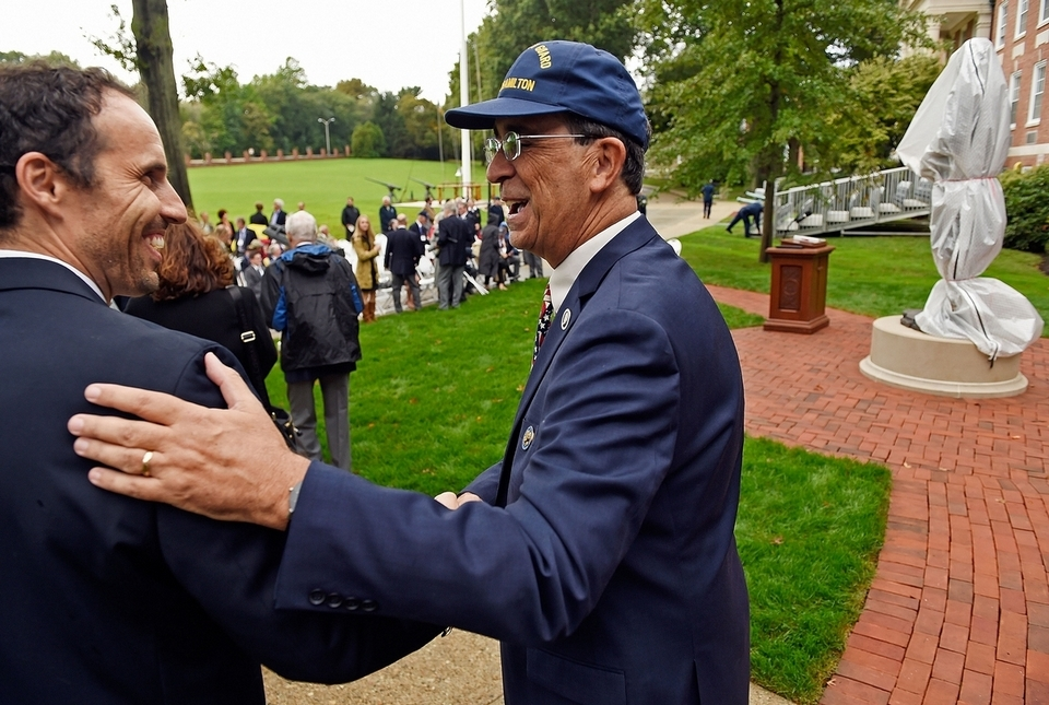 Rand Scholet, right, president of the Alexander Hamilton Awareness Society, greets sculptor Benjamin Victor at the unveiling of Victor's sculpture of Alexander Hamilton at the U.S. Coast Guard Academy, a gift of the Class of 1963, on Friday, Oct. 12, 2018, in front of Hamilton Hall at the academy in New London, Conn. (Sean D. Elliot/The Day)