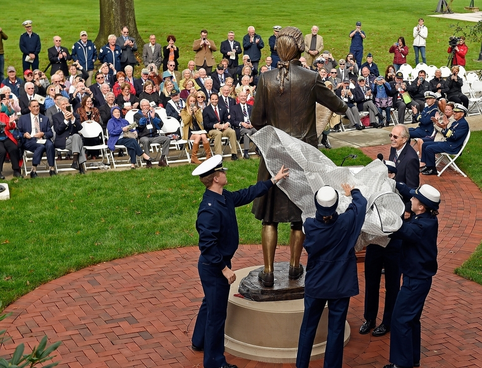 U.S. Coast Guard Academy Cadets, from left, first-class Matthew Nagle, first-class Madelynn Widmeier, fourth-class Juniana Curtis and fourth-class Katelynn Lane, remove the shroud to unveil a statue of Coast Guard founder Alexander Hamilton, given as a gift from the academy's Class of 1963 on Friday, Oct. 12, 2018, in front of Hamilton Hall at the academy in New London, Conn.  (Sean D. Elliot/The Day)