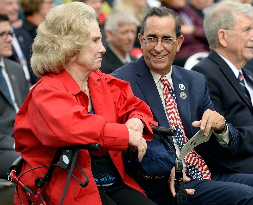Mary Anne Hamilton, left, widow of Laurens Morgan Hamilton, a great-great-grandson of founding father Alexander Hamilton, sits with Rand Scholet, right, president of the Alexander Hamilton Awareness Society, as the U.S. Coast Guard Academy Class of 1963 unveils a statue of Alexander Hamilton on Friday, Oct. 12, 2018, in front of Hamilton Hall at the academy in New London, Conn.  (Sean D. Elliot/The Day)