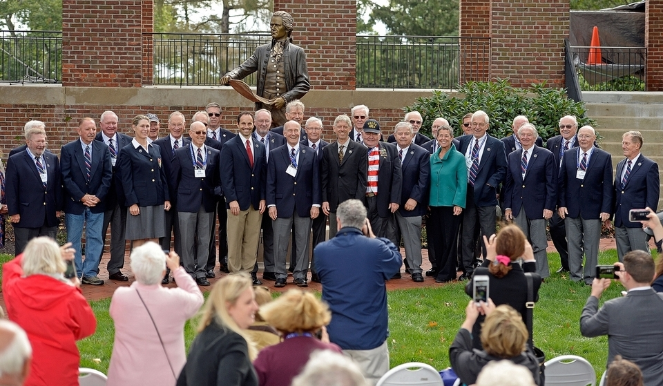 Members of U.S. Coast Guard Academy Class of 1963 gather for a photo with their gift to the academy, a statue of Coast Guard founder Alexander Hamilton, on Friday, Oct. 12, 2018, in front of Hamilton Hall at the academy in New London, Conn.  (Sean D. Elliot/The Day)