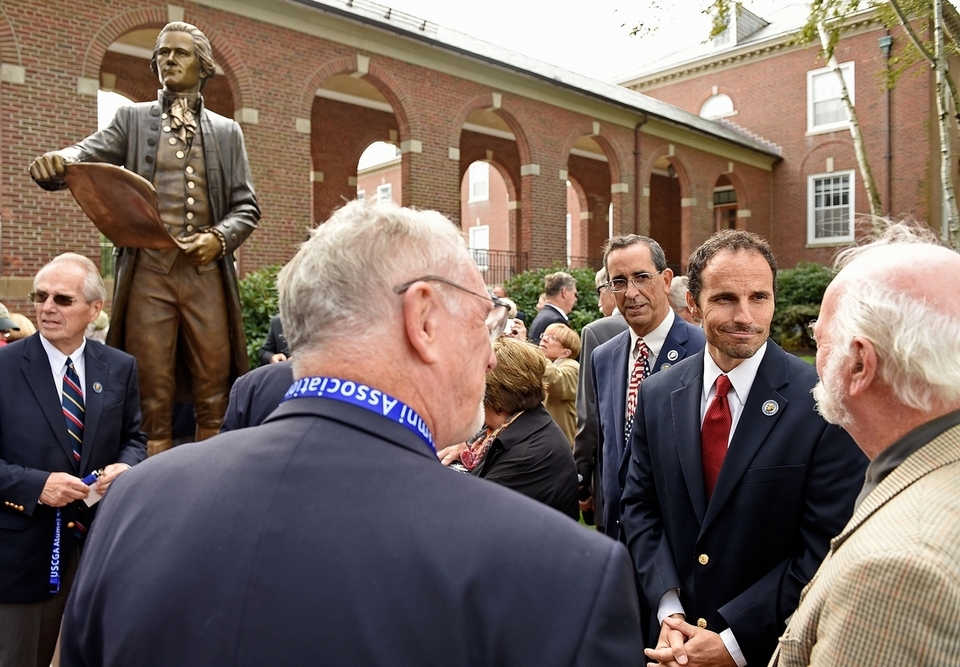 Sculptor Benjamin Victor, second from right, speaks with members of the U.S. Coast Guard Academy Class of 1963 and other guests after the unveiling of his sculpture of Coast Guard founder Alexander Hamilton as a gift from the Class of '63 to the academy Friday, Oct. 12, 2018, in front of Hamilton Hall at the academy in New London, Conn.  (Sean D. Elliot/The Day)