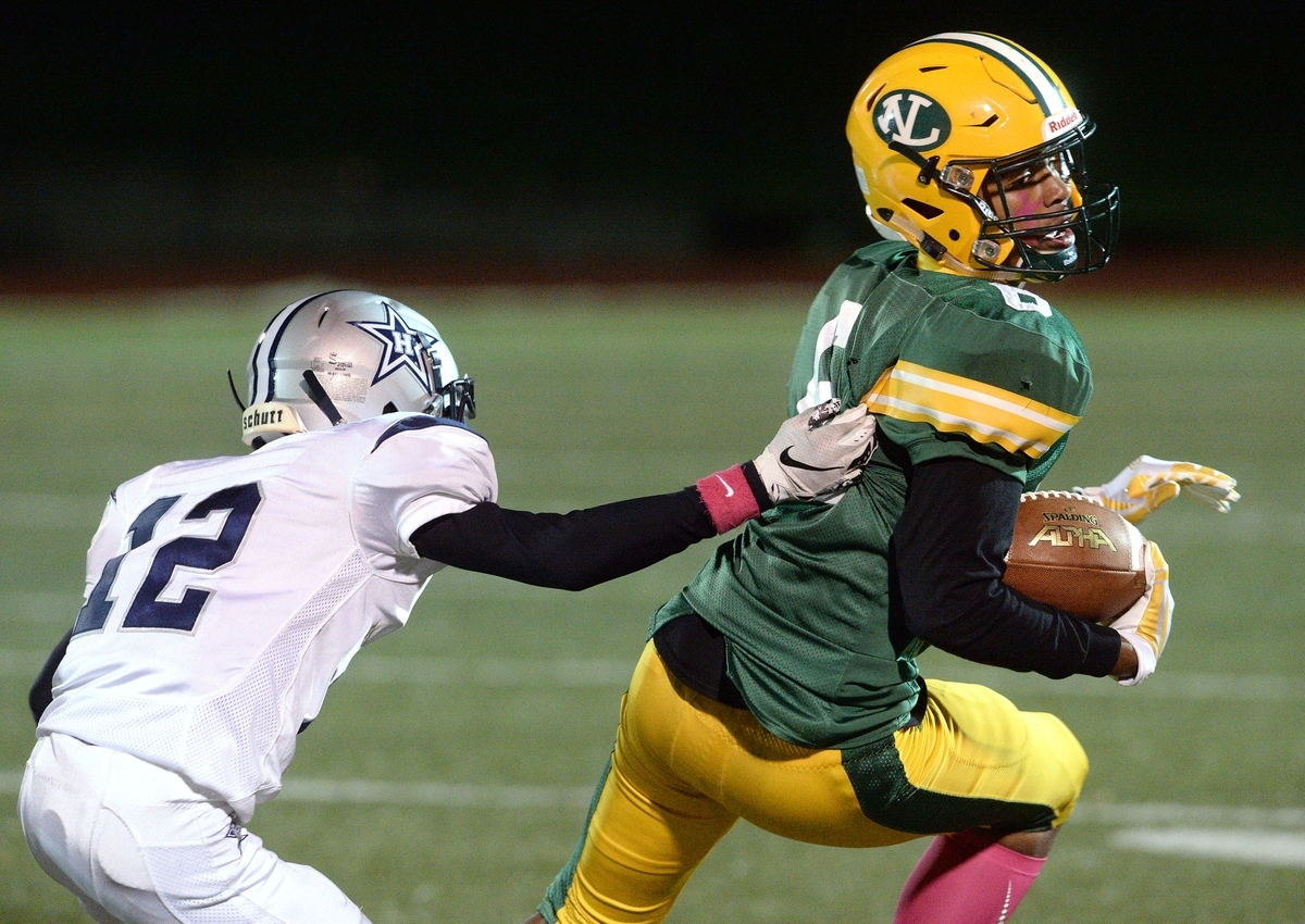 <b></b> New London's Frankie Pratts (6) twists away from the grasp of a Hillhouse player to gain some extra yardage during the Whalers' 26-7 loss on Friday night at Cannamela Field. (Dana Jensen/The Day)