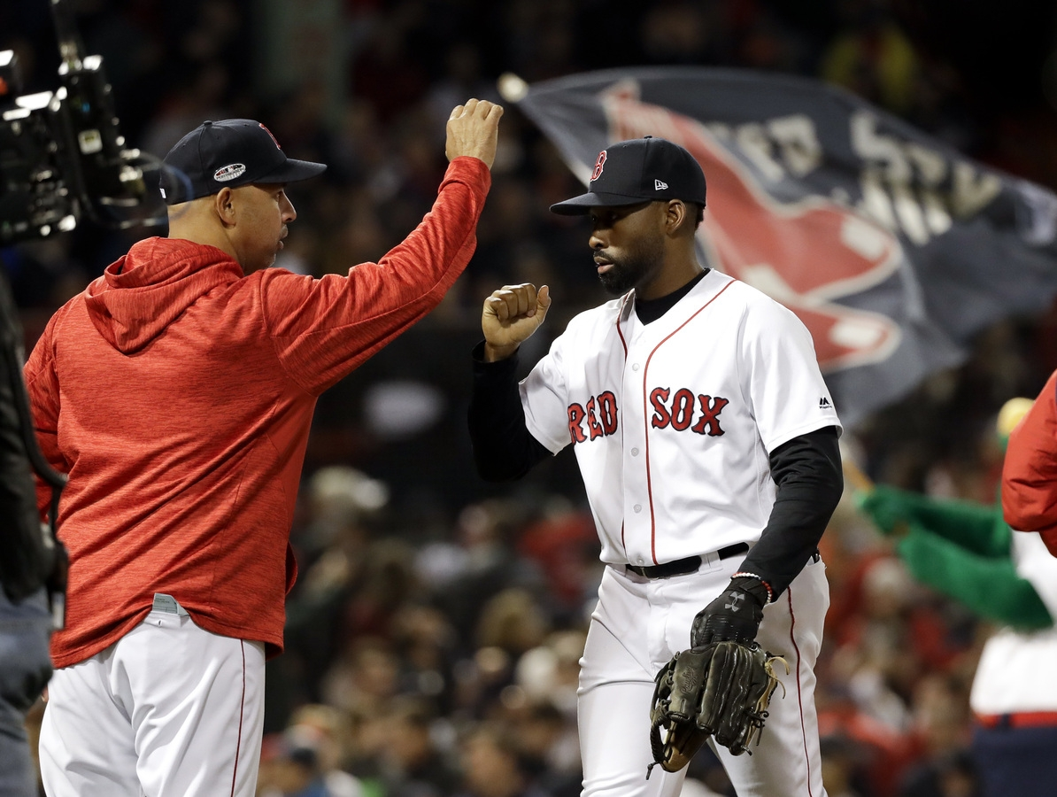 <b></b> Boston Red Sox manager Alex Cora, left, and center fielder Jackie Bradley Jr. celebrate after their 7-5 win against the Houston Astros in Game 2 of the American League Championship Series on Sunday at Boston. (AP Photo/David J. Phillip)