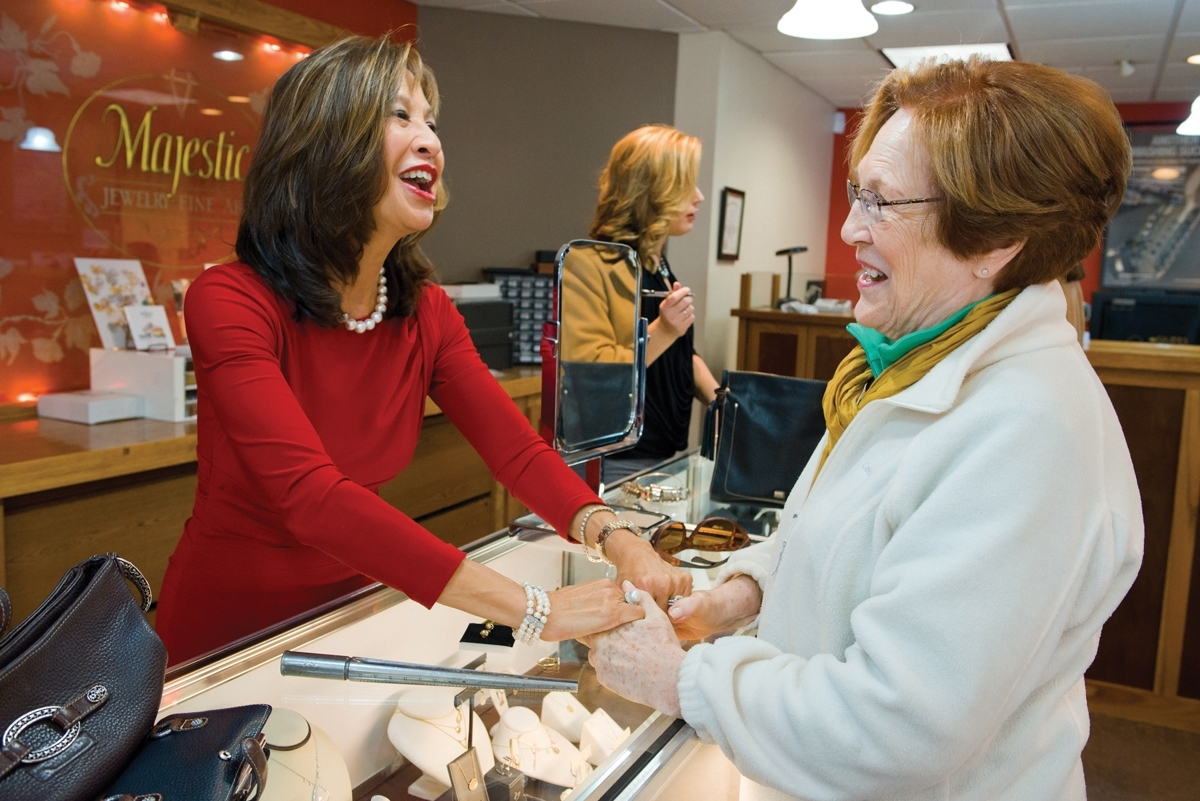 Simply Majestic co-owner Susette Tibus shares a happy moment with longtime customer Jean Tanczos. (Peter M. Weber photo)