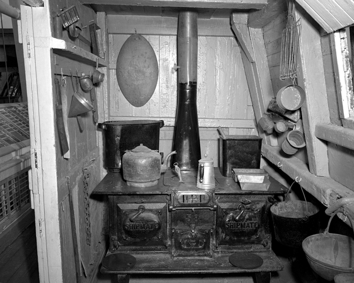 The galley of the Charles W. Morgan is shown. When the cook wasn't jumping ship (the job was one of the worst on board, in both status and pay) or being clapped in irons for insubordination or just plain lousy cooking, he might treat the crew to a batch of doughnuts, deep-fried in whale oil and traditionally served as a reward for securing every thousandth barrel of the precious commodity. (Photographs courtesy of Mystic Seaport)