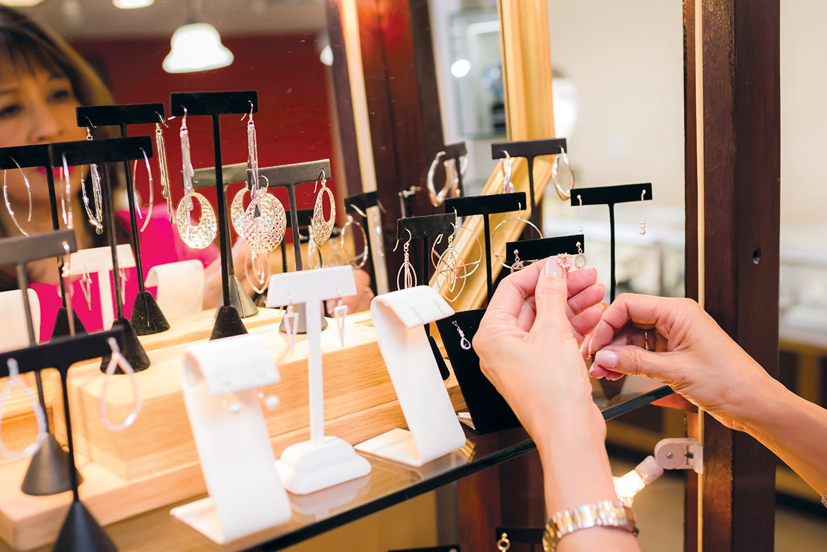 Susette Tibus arranges a display at Simply Majestic jewelers in Mystic. (Margit Fish photo)