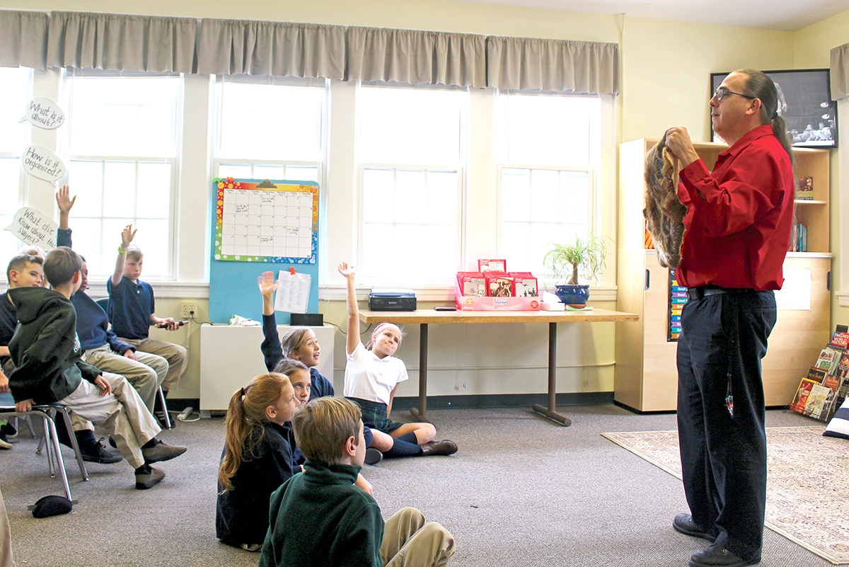 Akomawt Education Director Christopher Newell gives a presentation to students at The Unquowa School in Fairfield, Connecticut.