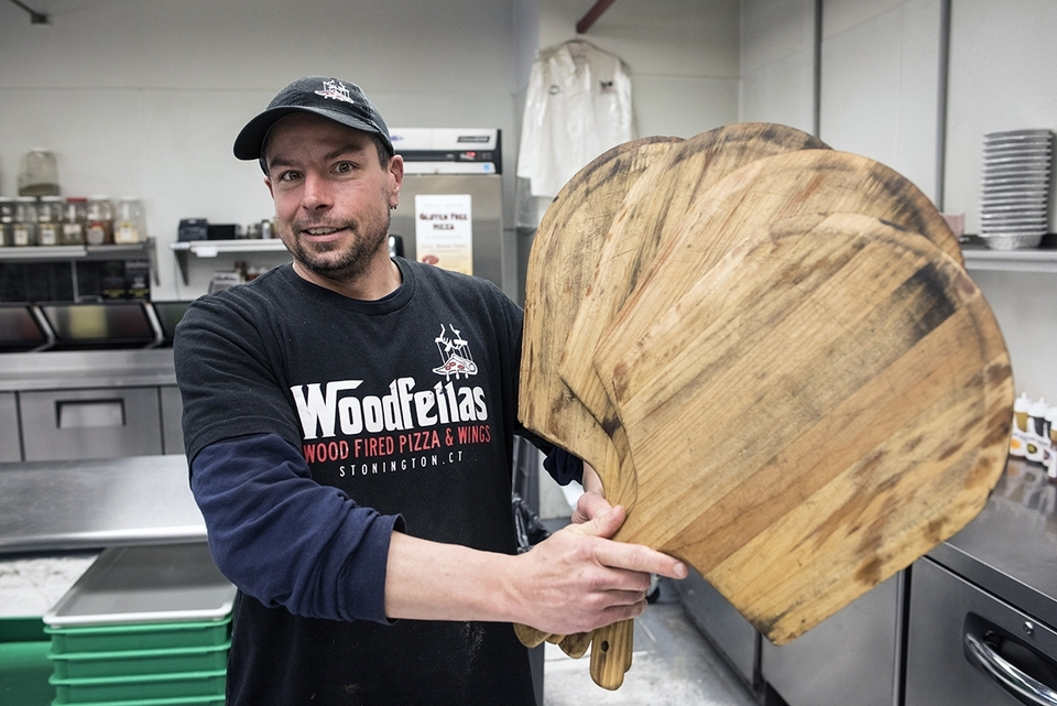 Rob Banker of Woodfellas shows off the wooden peels that the team uses on their famous wood-fired pizzas.(Peter M. Weber photo)