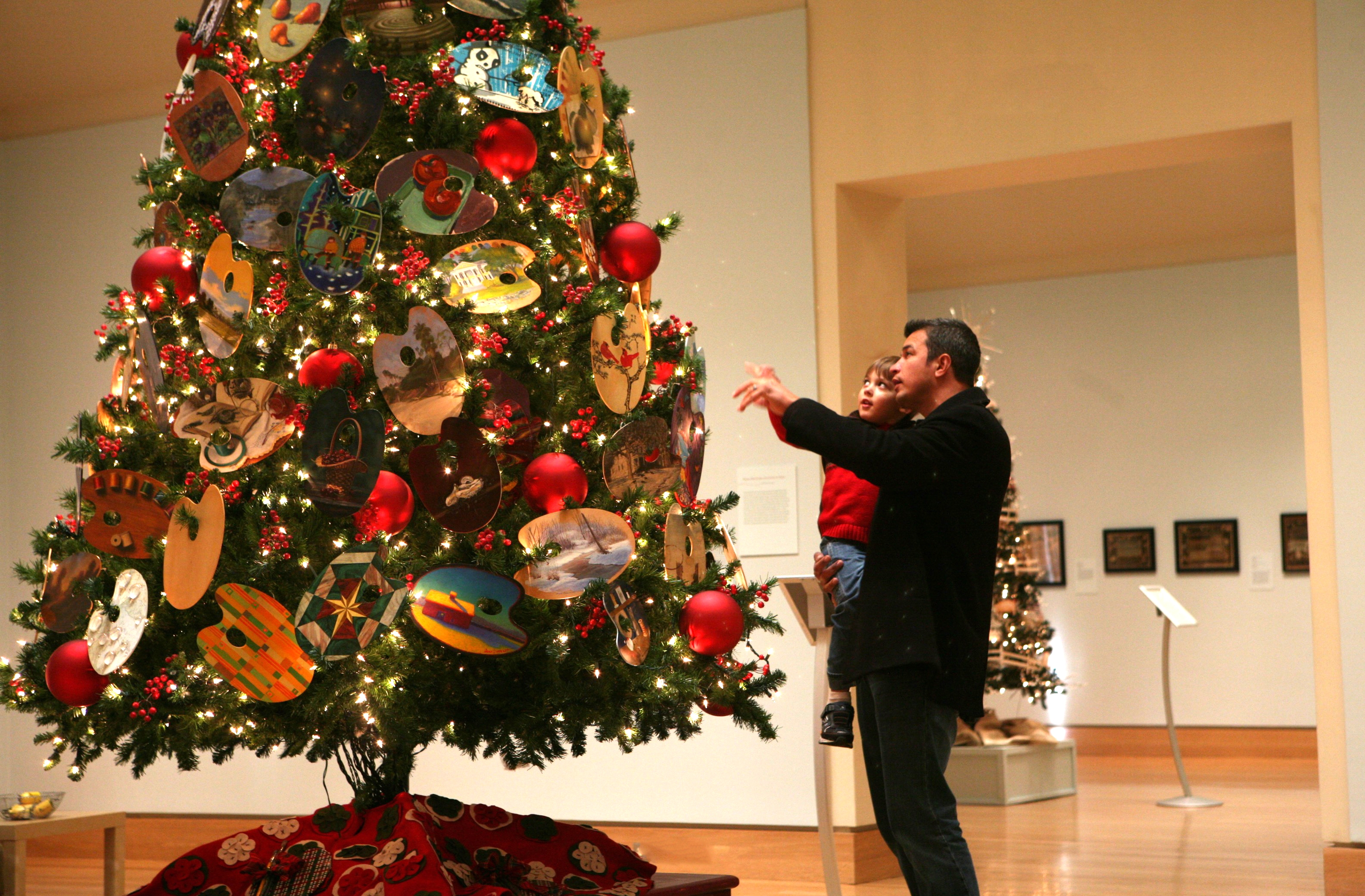 Visitors take in a tree of artists' palettes at the Florence Griswold Museum.